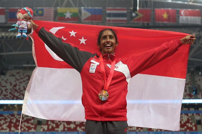 Singapore's Shanti Pereira clinched the bronze with a 11.88 effort, much to the approval of the home crowd. -- ST PHOTO: NEO XIAOBIN