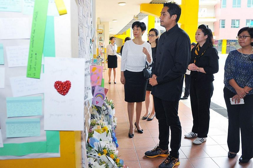 Malaysia's Youth and Sports Minister Khairy Jamaluddin (third from right) and his wife Nori (second from right), withSenior Minister of State for Law and Education Indranee Rajah (left) atTanjong Katong Primary School on June 9, 2015.&nbs