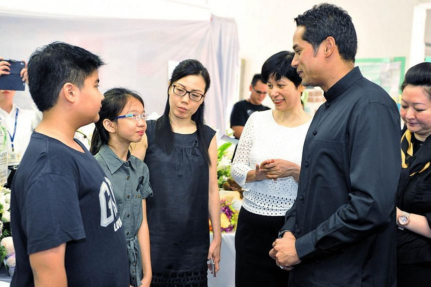 Malaysia's Youth and Sports Minister Khairy Jamaluddin (second from right) and his wife Nori (right), with Senior Minister of State for Law and Education Indranee Rajah (third from right) at Tanjong Katong Primary School on June 9, 2015.&nb