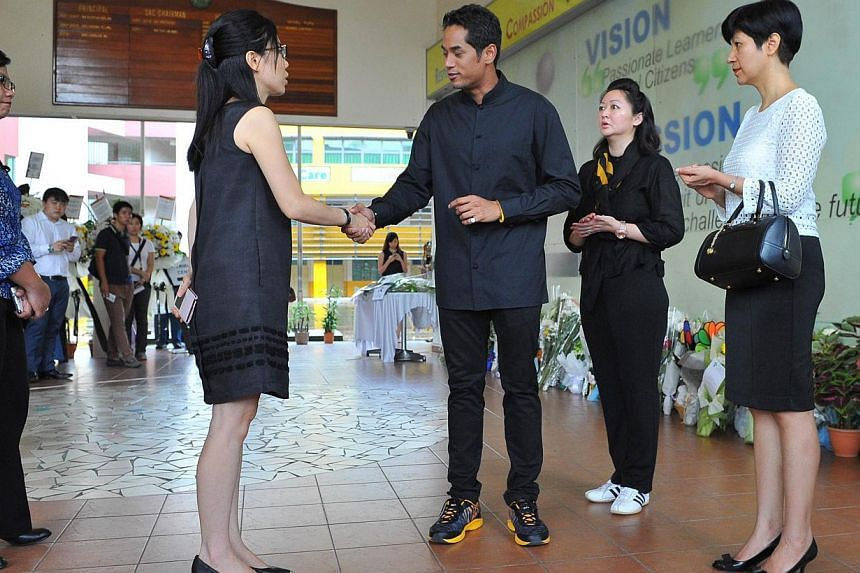 Malaysia's Youth and Sports Minister Khairy Jamaluddin (second from left) and his wife Nori (second from right), with Senior Minister of State for Law and Education Indranee Rajah (right) at Tanjong Katong Primary School on June 9, 2015. --
