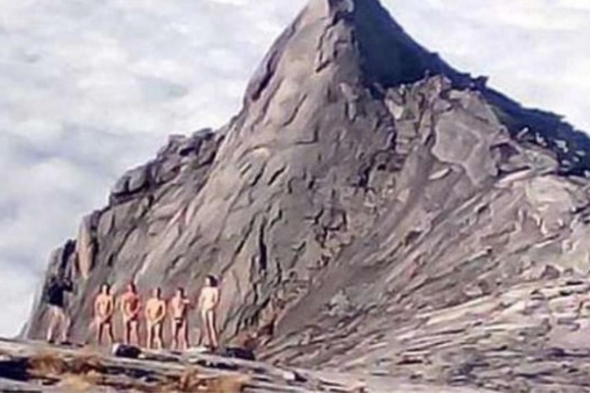 The stripping stunt by 10 foreign tourists on Mount Kinabalu was the latest in a series of offences committed by climbers over the years, say guides. -- PHOTO: THE STAR/ASIA NEWS NETWORK