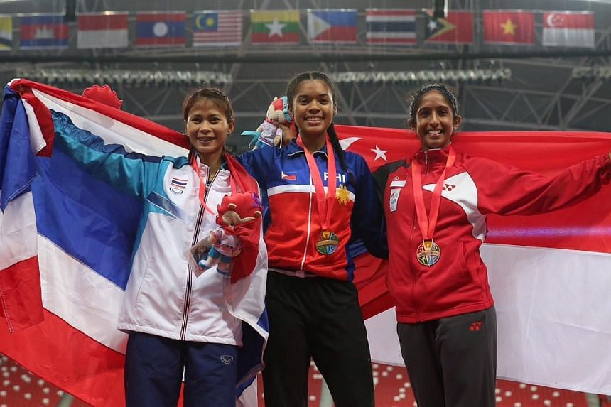 (From left) Thailand's Tassaporn Wannakit (silver), Philippines' Kayla Anise Richardson (gold) and Singapore's Shanti Pereira (bronze) on the podium after the women's 100m final at the National Stadium on June 9, 2015. -- ST PHOTO: NEO XIAOBIN
