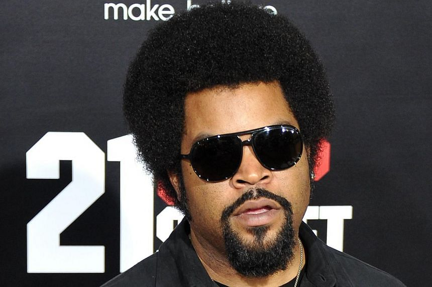 In this March 13, 2012 file photograph, actor and musician Ice Cube poses for pictures during the premiere of 21 Jump Street held at Grauman's Chinese Theatre in Hollywood, California. Members of N.W.A., the pioneering gangsta rappers whose furious t