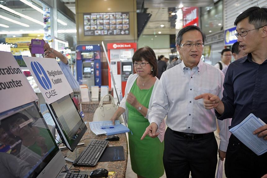 (Left to Right) Mayor for Central Singapore District Denise Phua, Consumers Association of Singapore (Case) president Lim Biow Chuan and Minister of State for Trade and Industry Teo Ser Luck visiting shops at Sim Lim Square on May 22, 2015. The Consu