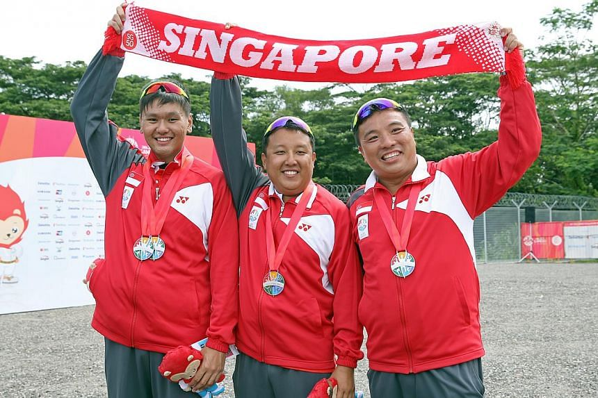 Singapore's men's skeet team silver medallists (from left) Low Jiang Hao, Eugene Chiew and David Chan at the National Shooting Centre on June 9, 2015. -- ST PHOTO: SEAH KWANG PENG