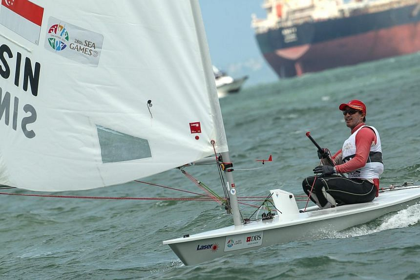 Colin Cheng scored Singapore's first sailing gold medal in the men's Laser Standard event. -- PHOTO: LIANHE ZAOBAO