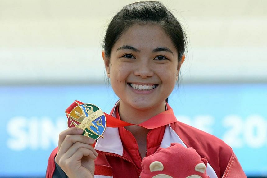 Singapore bowler Daphne Tan with her gold medal after winning the women's singles on June 9, 2015. -- ST PHOTO: DESMOND FOO