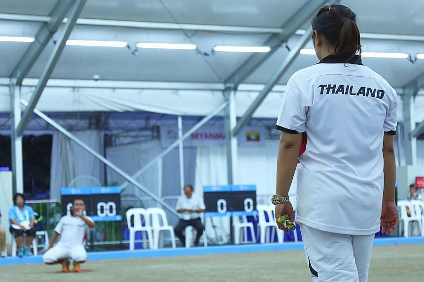 Thailand affirmed their status as South-east Asia's petanque powerhouse by clinching their third gold on June 9, 2015. -- ST PHOTO: JEREMY LIM