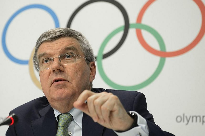 """The President of the International Olympic Committee (IOC) Thomas Bach speaks to the media at the end of an IOC Executive Board meeting in Lausanne, on Monday (June 8). Bach said on June 8 that scandal-plagued FIFA needs """"painful"""" but necessary refor"""