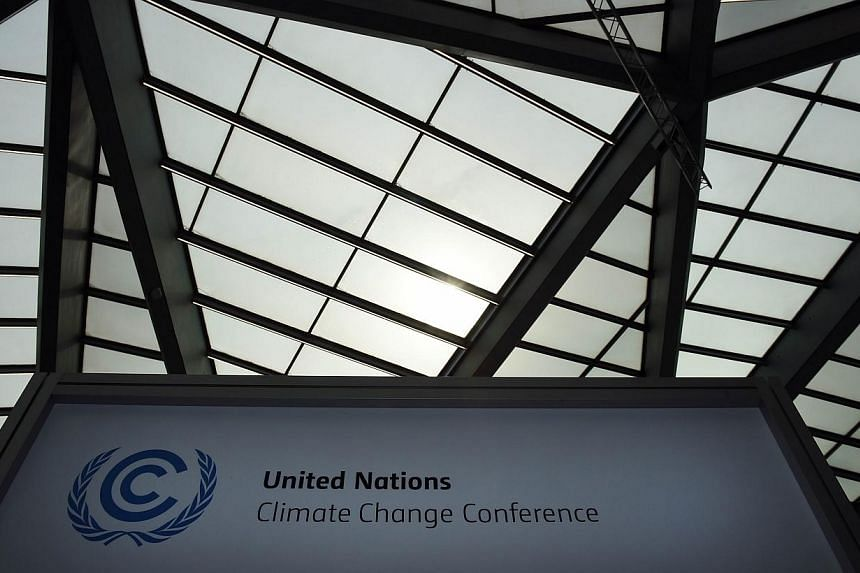 A sign for the United Nations Framework Convention on Climate Change (UNFCCC) is continuing place at the Bonn conference centrum until Thursday (June 11). -- PHOTO: AFP