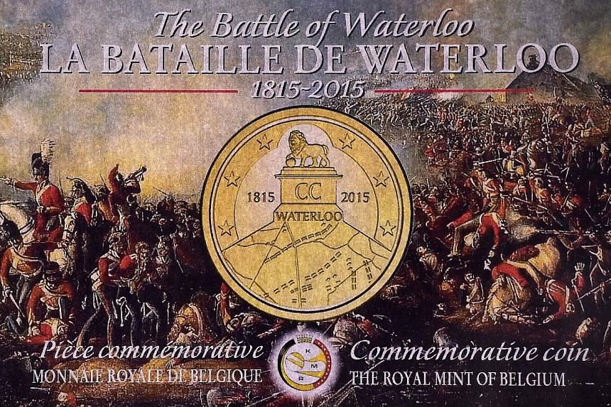 A picture shows a reproduction of a poster released by the Royal Mint of Belgium for commemorative coins marking the 200th anniversary of The Battle of Waterloo during a ceremony at the Royal Belgium Mint in Brussels in Brussels on Monday (June 8). -