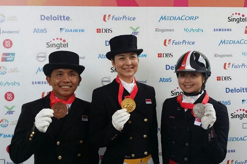 Indonesia's top dressage rider Gading Larasati (centre) with her SEA Games gold medal in the individual dressage event on June 9, 2015. Singapore's Caroline Chew (right) claimed silver while Gading's compatriot Menayang Alfaro (left) got the bronze.