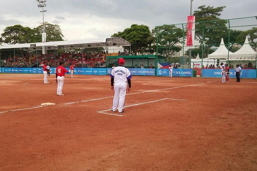 Singapore's men's softball team (in red) taking on the Philippines in their SEA Games semi-final match at the Kallang Softball Field on June 9, 2015. -- ST PHOTO: CHARLES ONG