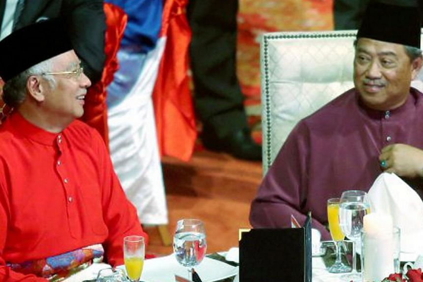 Malaysian Prime Minister Najib Razak (left) with Deputy Prime Minister Tan Sri Muhyiddin Yassin at the 2015 Umno Supreme Council meeting at the Putra World Trade Centre on May 12, 2015. -- PHOTO: NSTP