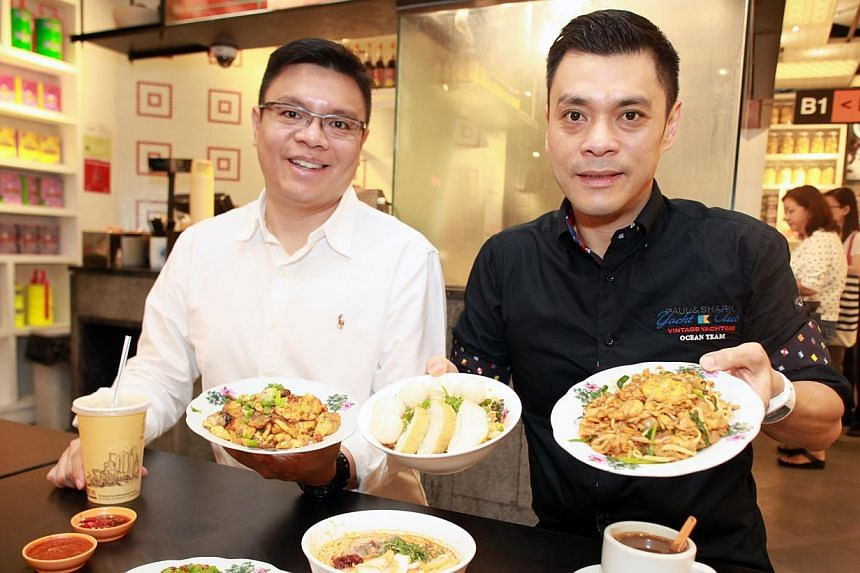 Fei Siong's group managing director Tan Kim Siong (right) and executive director Tan Kim Leng (left) want to preserve Singapore's food culture by getting old hawkers to share their recipes. -- PHOTO: MIKE LEE FOR THE STRAITS TIMES