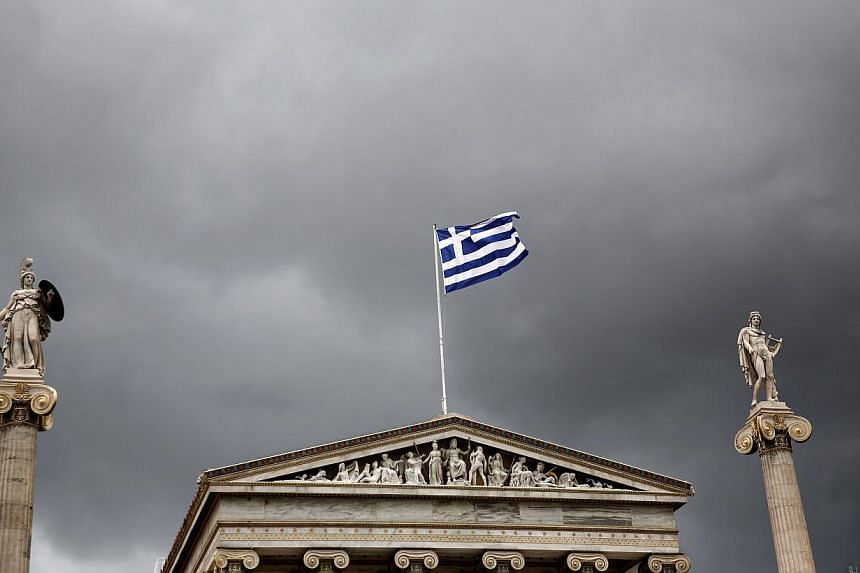 Statues of the Greek goddess Athena (left) and god Apollo flank Greece's national flag atop the Athens Academy. Greece has made clear its willingness to engage in continued reforms. A dose of reality on the part of Greece's creditors - about what is