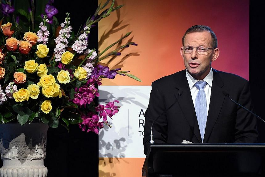 Australian Prime Minister Tony Abbott delivers his key notes at the Regional Countering Violent Extremism Summit in Sydney on June 11, 2015. -- PHOTO: AFP