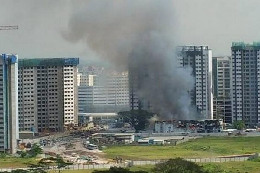 A fire broke out at a construction site for a Build-to-Order estate at Keat Hong Link Road on Thursday morning. -- PHOTO: SHIRLEY WONG