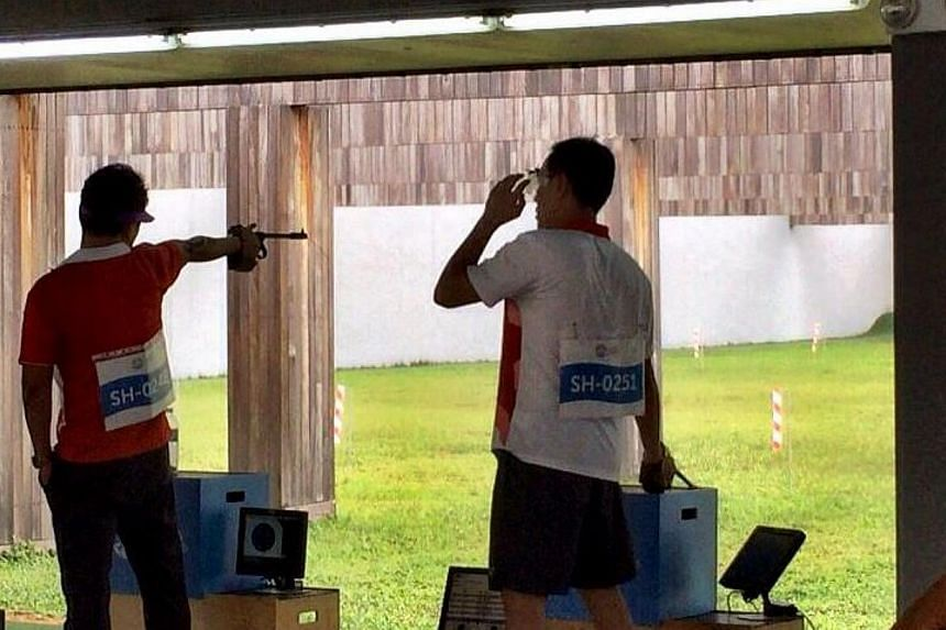 Host Singapore's 50m pistol team of Gai Bin, Nigel Lim and Poh Lip Meng struck their first gold at this SEA Games, combining to register 1,632 points, ahead of Vietnam (1,626) and Malaysia (1,615). -- PHOTO: ST SPORTS DESK/TWITTER