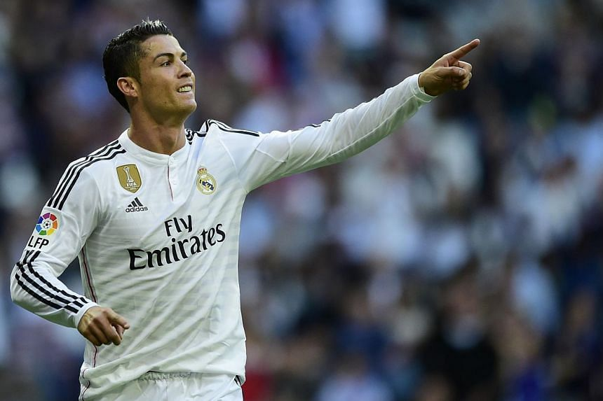 Real Madrid's Portuguese forward Cristiano Ronaldo celebrates after scoring against Getafe at the Santiago Bernabeu stadium in Madrid on May 23, 2015. Ronaldo remains Europe's and the world's most marketable footballer, according to a study released
