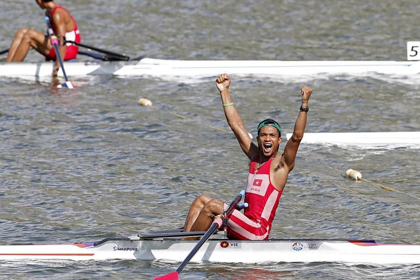 Vietnam's Nguyen Van Linh (bottom) celebrating his win in the lightweight single sculls event on June 11, 2015. -- PHOTO: REUTERS