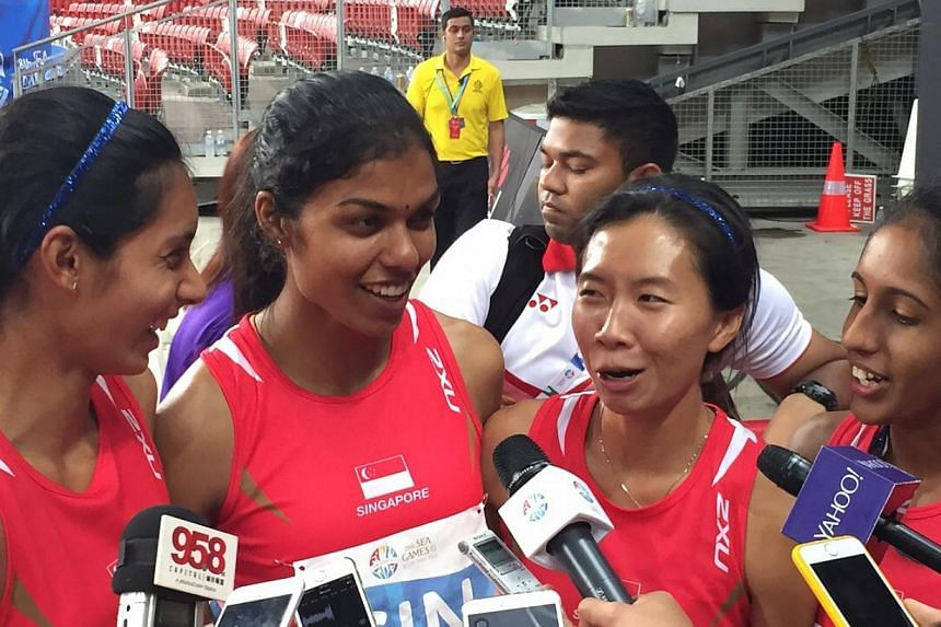 Singapore's 4x400m relay quartet of (from left) Dipna Lim-Prasad, T. Piriyah, Goh Chui Ling and Shanti Pereira smashed a 41-year-old national record but could only finish fourth. -- ST PHOTO: MAY CHEN