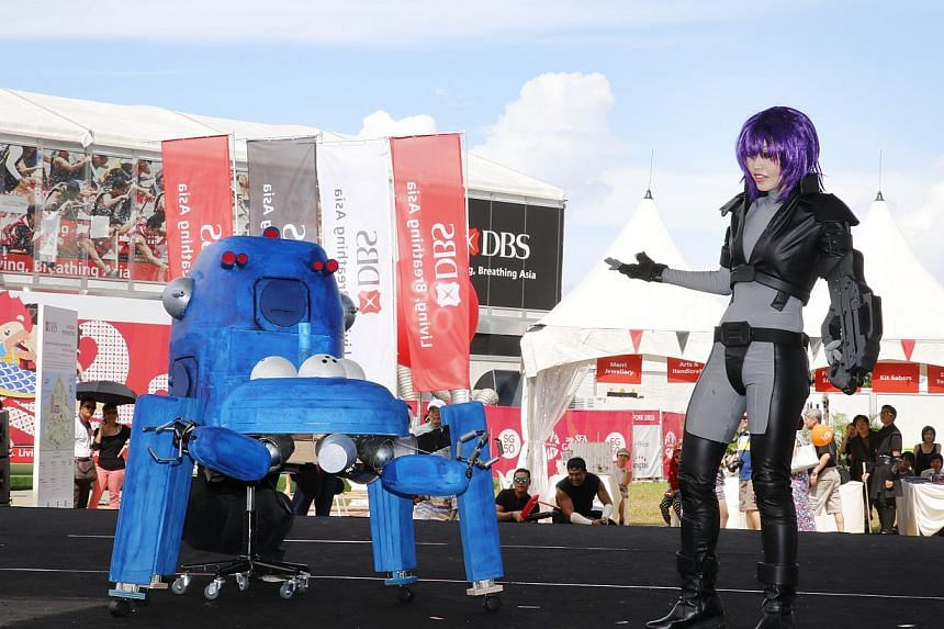 Ms Jaslyne Chia (right), 37, played the character Major Motoko Kusanagi from anime series Ghost In The Shell in a cosplay competition at the DBS Marina Regatta last Sunday and emerged the winner. With her is the robot Tachikoma, which she made hersel