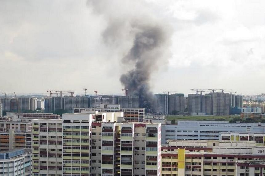A fire broke out at a construction site for a Build-to-Order estate at Keat Hong Link Road on Thursday morning.Large plumes of smoke could be seen from the neighbouring estate of Bukit Batok. -- PHOTO: FAIZAL HASSAN