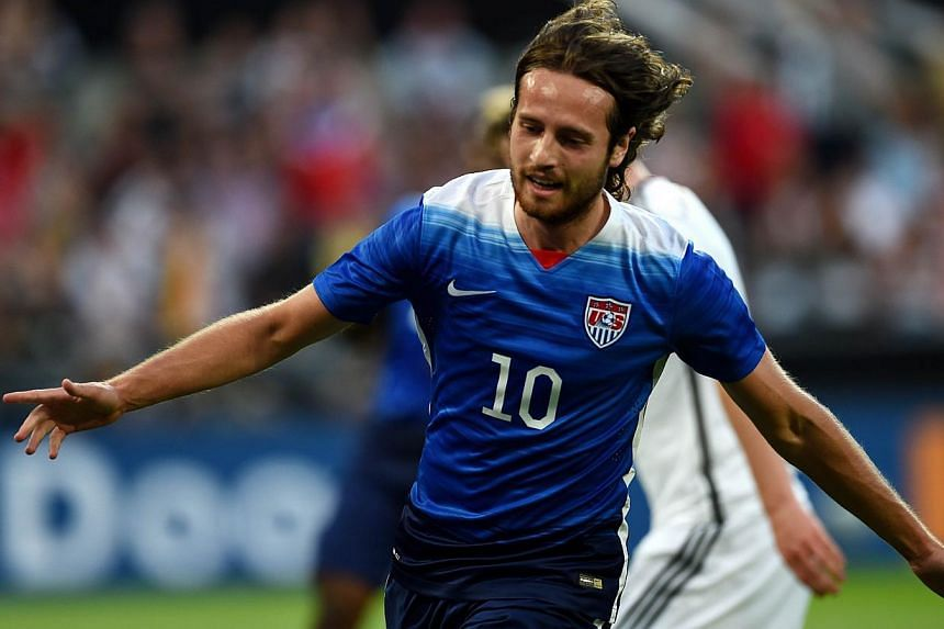 US midfielder Mix Diskerud celebrates scoring the equaliser during the International friendly football match between Germany and the US in Cologne, Germany on June10, 2015. The US won the match 2-1. -- PHOTO: AFP