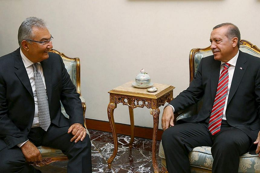 Turkey's President Recep Tayyip Erdogan (right) meets with Mr Deniz Baykal, a veteran opposition lawmaker from the Republican People's Party (CHP), in Ankara, Turkey, on June 10, 2015. -- PHOTO: REUTERS