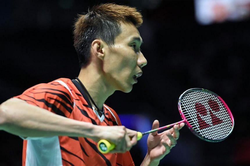 Malaysia's Lee Chong Wei in action during the SEA Games' badminton competition. -- PHOTO: AFP