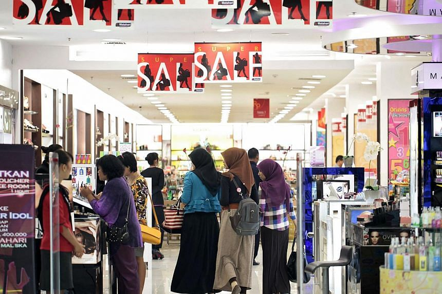Customers browse inside the Mal Ska shopping mall in Pekanbaru, Riau province, Indonesia. The country is exempting most goods from a luxury tax in a bid to boost household consumption and revive faltering economic growth, says Jakarta's finance minis