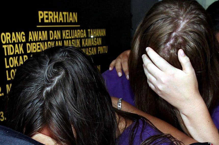 Two of the four tourists remanded by police for desecrating Mount Kinabalu, a sacred site, have confessed to going naked while on the mountain.-- PHOTO: THE STAR/ASIA NEWS NETWORK