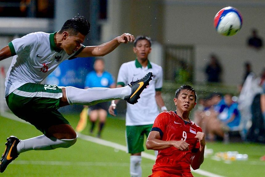 Singapore crashed out of the SEA Games football tournament after losing 0-1 to Indonesia in their final Group A match on Thursday evening. -- ST PHOTO: DESMOND FOO