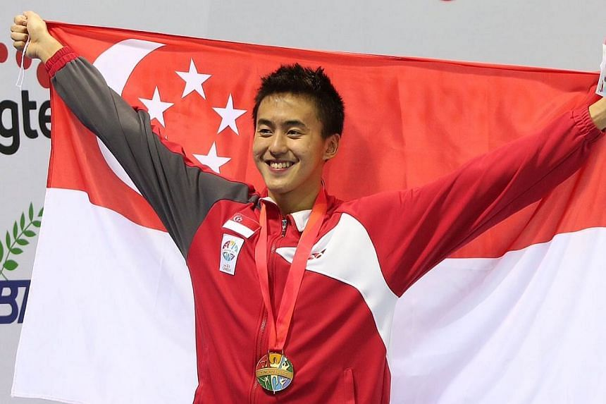 Singapore's Quah Zheng Wen wins the gold medal for the 28th SEA Games swimming men's 50m backstroke final held at the OCBC Aquatic Centre on June 11, 2015. - ST PHOTO: NEO XIAOBIN