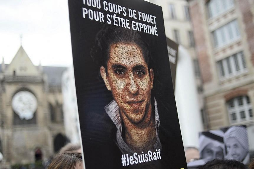 """People demonstrate in support of Raif Badawi, who was sentenced to 1,000 lashes for """"insulting Islam"""", on May 7, 2015, in Paris. -- PHOTO: AFP"""