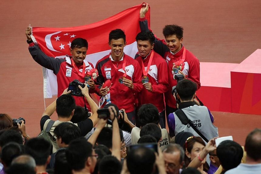 Singapore's 4x100m relay quartet of (from left) Amirudin Jamal, Lee Cheng Wei, Gary Yeo and Calvin Kang with their silver medals after the race on June 12, 2015. -- ST PHOTO: NEO XIAOBIN