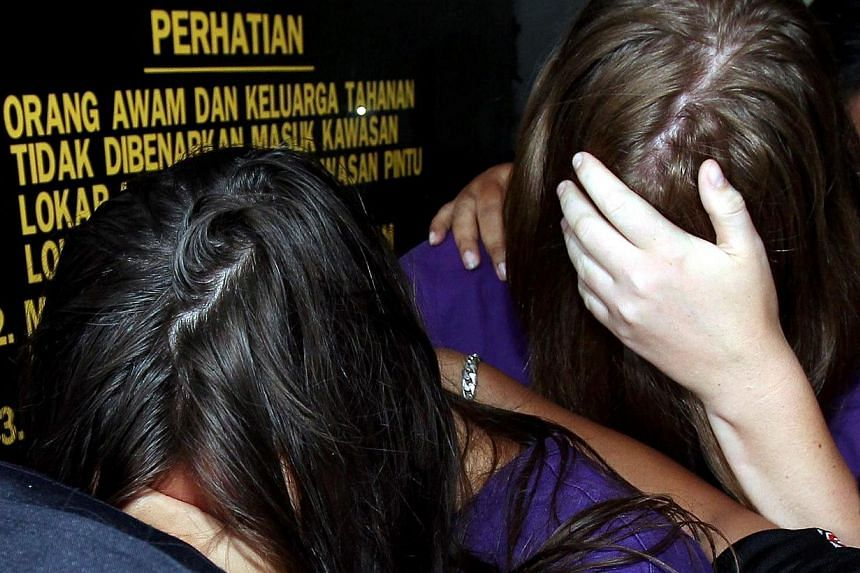 All four foreigners who allegedly stripped on Mount Kinabalu on May 30 have pleaded guilty to a charge of obscene behaviour in a public place. -- PHOTO: THE STAR/ASIA NEWS NETWORK