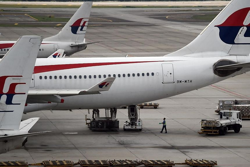 A Malaysia Airlines (MAS) flight returned safely to Melbourne on Friday, having turned back within minutes of take-off after an engine fire alert went off, Air Services Australia said. -- PHOTO: AFP
