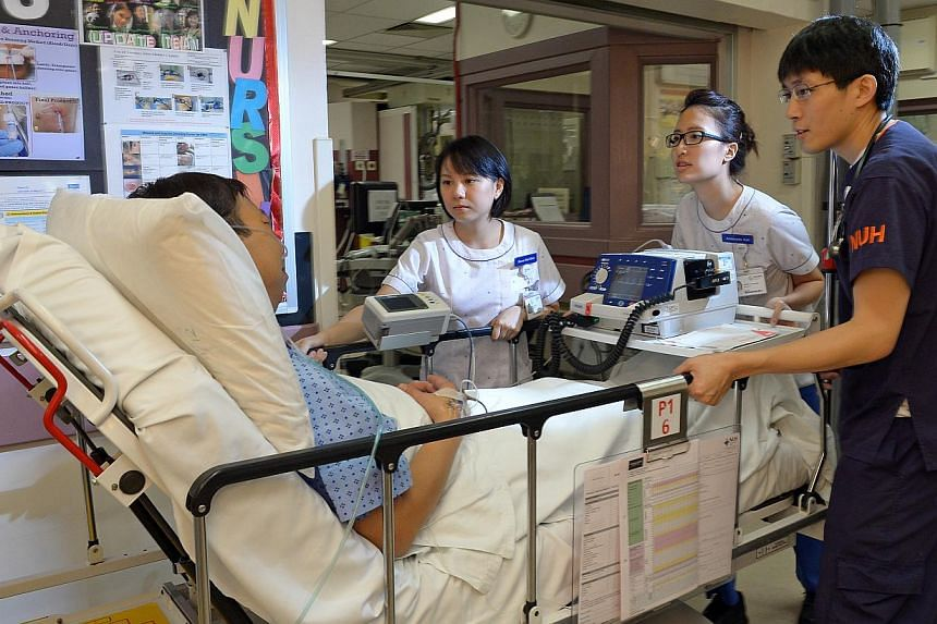 Healthcare staff from the National University Hospital are now able to tap on an extra $120,000 a year to train their peers in South-east Asia and China. -- ST FILE PHOTO