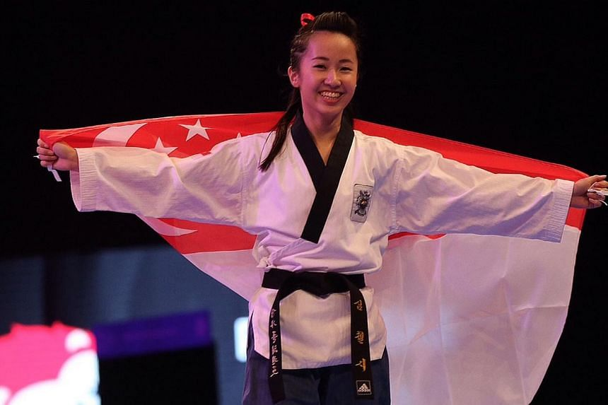 Taekwondo exponent Chelsea Sim celebrating her win in the women's individual poomsae final. -- ST PHOTO: NEO XIAOBIN