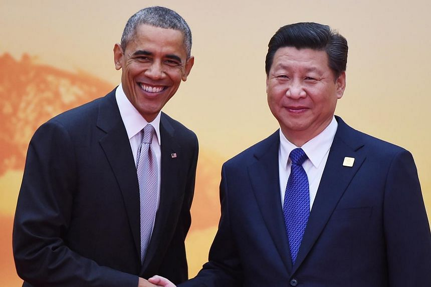 US President Barack Obama and Chinese President Xi Jinping at the Asia-Pacific Economic Cooperation summit last November. Looking to the future, the key responsibility for their countries is to learn how to manage competition and keep it from edging