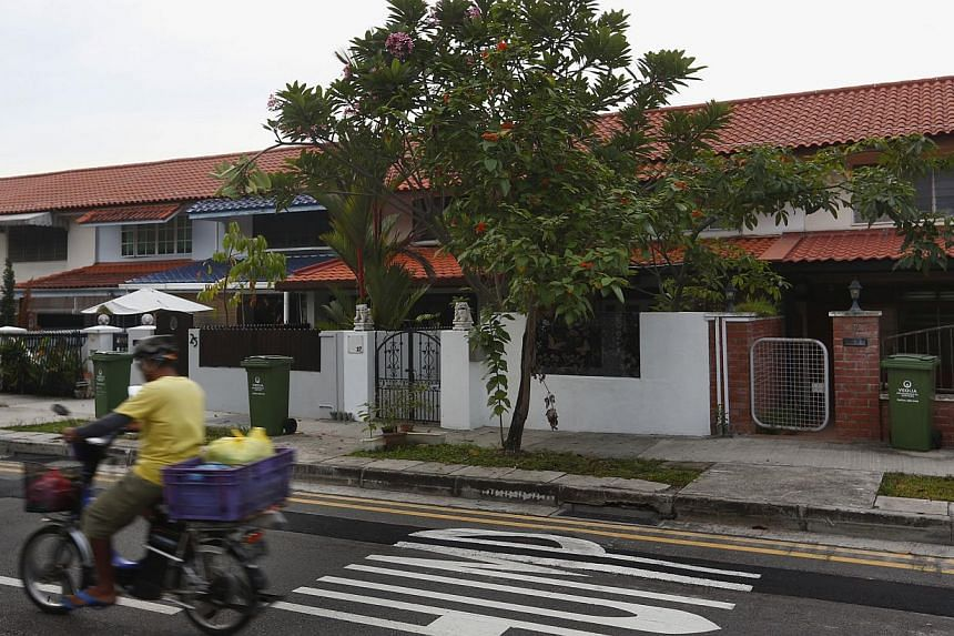 """A two-storey unit in Jalan Bahagia (above) went for about $370 psf, while prices for private landed terraced houses nearby have exceeded $2,200 psf this year. In all, 285 such """"landed public homes"""" were built by the Singapore Improvement Trust, HDB's"""