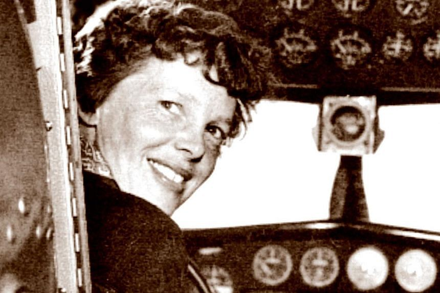 A May 20, 1937, photo shows US aviator Amelia Earhart at the controls of her Lockheed 10 Electra. -- PHOTO: AFP