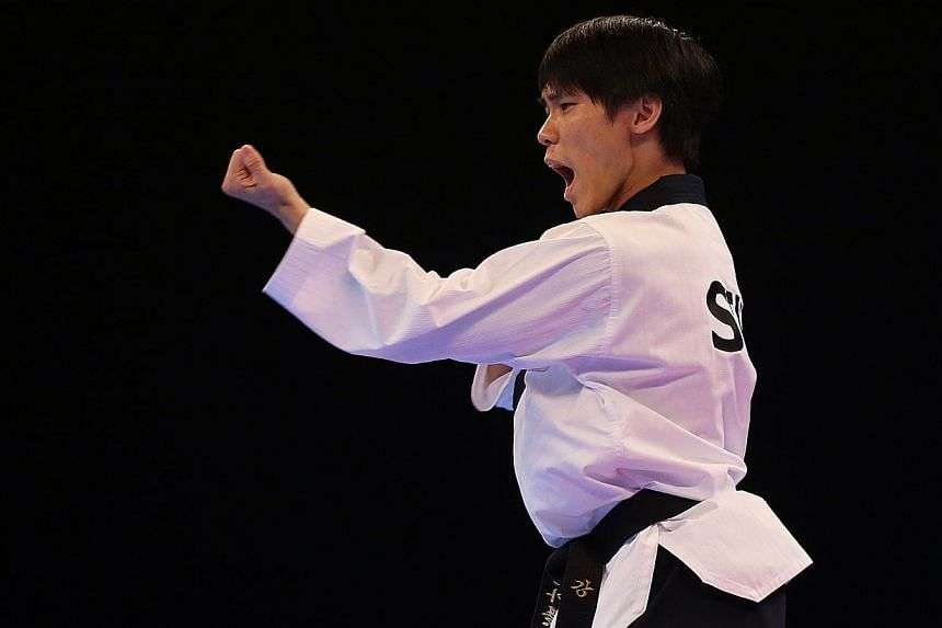 Singapore's Kang Rui Jie won the gold medal for the 28th SEA Games men's individual poomsae finals held at the Singapore Expo Hall 2 on June 12, 2015. -- ST PHOTO: NEO XIAOBIN