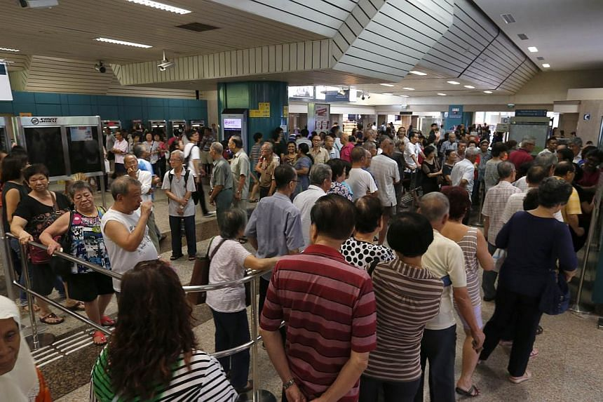 """The queue at Ang Mo Kio MRT Station at 4.30pm on Friday (June 12). """"There is no need to rush to redeem the voucher as the redemption period is until the end of next year (Dec 31, 2016),"""" said the Ministry of Health and the Ministry of Transport in a"""