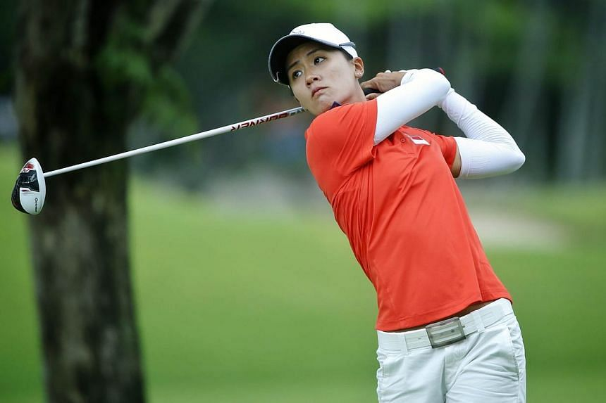 Singapore's Koh Sock Hwee tees off on the ninth green during the 28th SEA Games golf women's individual at Sentosa Golf course on June 12, 2015.-- ST PHOTO: KEVIN LIM