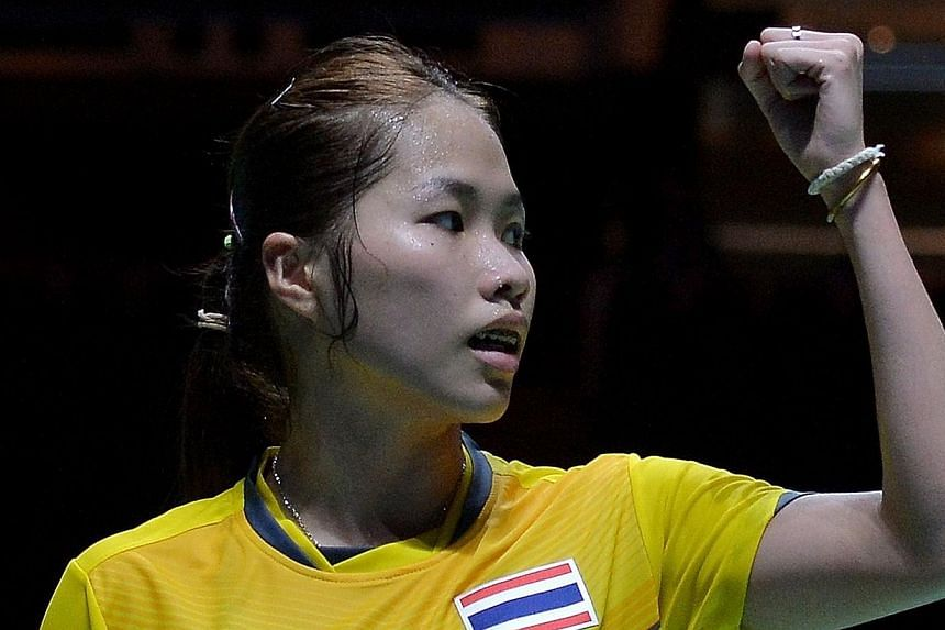 Ratchanok Intanon of Thailand reacts after winning a point against Lim Yin Fun of Malaysia in their women's team badminton final match during the 28th SEA Games in Singapore on June 12, 2015. -- PHOTO: AFP