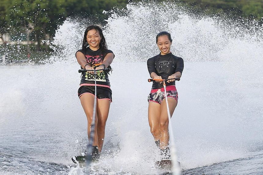 Waterskiing sisters Kalya (left) and Sabelle Kee were unable to get a gold medal in the women's trick competition, which was won by Malaysia's Aaliyah Hanifah-Yoong, at the Bedok Reservoir on June 12, 2015. -- ST PHOTO: KEVIN LIM