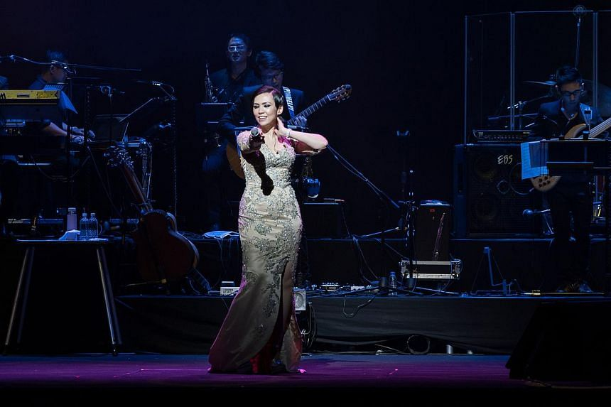 Homegrown singer Kit Chan performing at her Spellbound concert held at the Star Theatre on June 12, 2015. -- PHOTO: ALOYSIUS LIM